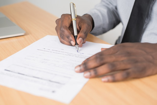 signing a contract or lease