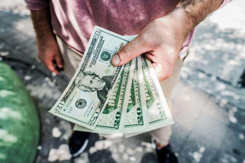 man holding money rent