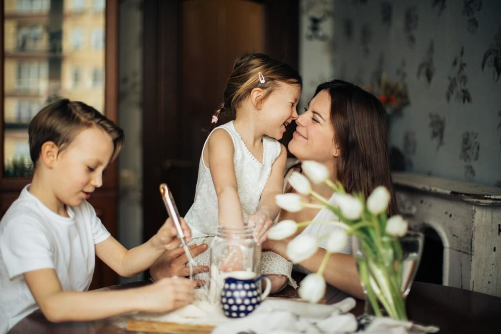 mother with kids smiling